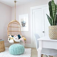 Hanging chair. Gold planter. Walls are Benjamin Moore Wild Aster.