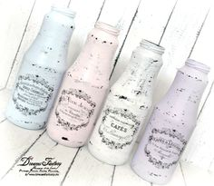Shabby chic bottles using French typography transfers found on The Graphics Fairy.