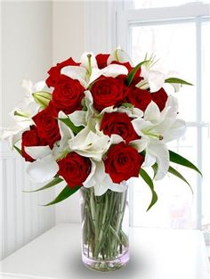 Wedding flowers centerpieces hogar pinterest red wedding these look pretty together lily and rose bouquet lilies and roses mightylinksfo