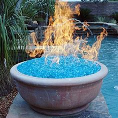 Fire glass produces more heat than real wood, and is also environmentally friendly. There is no smoke, it's odorless and doesn't produce ash. Plus it looks cool. I want a fire pit just for this! I'd probably even camp out in the yard! Living Pool, Outdoor Living, Outdoor Decor, Outdoor Stuff, Outdoor Ideas, My Pool, Fire Glass, Glass Rocks, Glass Pool