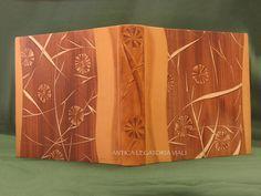 """Album fotografico rilegato in 1/2 pelle bovina e carta alla colla di """"Musardises d'Hippocrène"""".  Dorso con motivo della carta in rilievo e colorato a mano.  Dorso e bordo piatto sagomato.  Dimensioni cm 30 x 30 - 50 fogli #legatoria #legatoriaviali #viterbo #rilegature #bookbinding #bookbinder #rilegatura #artesan #artigianato #artigiano #italie #italia #libri #books #artigianatoartistico #rilegatore #orvieto #roma #tusciaviterbese #tuscia #fotografia #reliure #albumfotografico #foto Bookbinding, Book Design, Neon, Patterns, Paper, Photos, Book Binding, Italy, Sketches"""