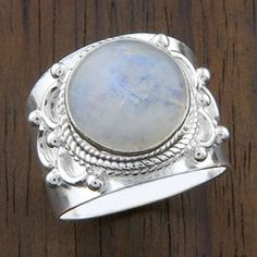 @Overstock.com - Sterling Silver 'Crafted Edge' Moonstone Ring (India) - Brighten up your wardrobe with this gorgeous silver moonstone ring. A delicate scallop and bead detail and a round moonstone give this piece of handmade jewelry a sophisticated and stylish look. This sterling silver ring was made in India.  http://www.overstock.com/Worldstock-Fair-Trade/Sterling-Silver-Crafted-Edge-Moonstone-Ring-India/3183836/product.html?CID=214117 $46.99