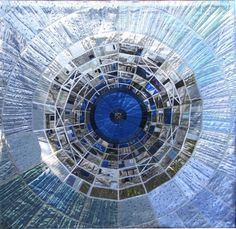 Into the Eye - a quilt image of the Large Haldron Collider. Kate Findlay uses metallic fabrics, creating this unique effect.