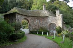 Gated entrance to the Worthy Combe Toll Road, Somerset, UK ring the bell and you can pass through for a quid!