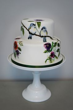 Our latest wedding cake, a bird and wild flowers 2-tier hand painted cake
