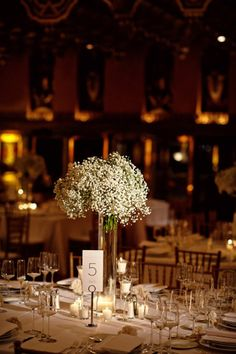 I want babys breath or Queen Anne's lace arrangements on the bar, the guestbook table, and the cake table.