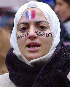 A girl wearing her head scarf, with the French flag and ''liberty, equality'' painted on her face, chants slogans as about 1,000 persons demonstrated in Paris on Sunday to protest against a planned law banning Islamic head scarves and other religious insignia in public schools. French President Jacques Chirac asked parliament to pass the law in a dramatic move. — AP/PTI