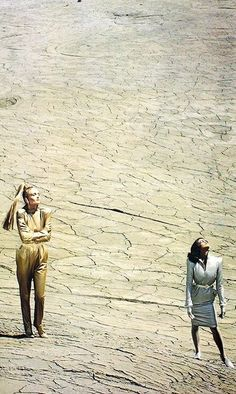 Thierry Mugler gold and silver 1979 gold jump suit blue silver dress big padded shoulder color photo print ad designer late 70s iconic vintage retro repro fashion styles look back at 40s inspirations