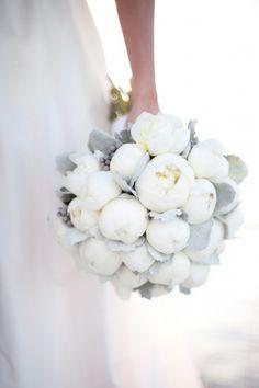 Stunning,  beautiful peonies look like puffs of cotton winter wedding bouquet
