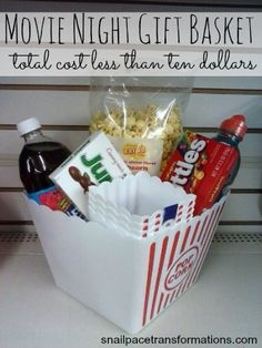 Dollar Store Gift Baskets for Everyone on Your List - Caitlyn Davis - Dollar Store Gift Baskets for Everyone on Your List Make a Dollar Tree Movie Night Gift Basket - Date Night Gift Baskets, Movie Basket Gift, Movie Night Gift Basket, Date Night Gifts, Movie Gift, Themed Gift Baskets, Raffle Baskets, Diy Gift Baskets, Christmas Gift Baskets