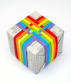 Giftwrap Idea: Newspaper and woven colored paper strips (could also use woven ribbon)