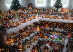 A Christmas village constructed by Dominic and Karen Leto is displayed Thursday in their home, which is along the 7000 block of Egypt Road in Lafayette Township. Dominic Leto said it takes about three weeks to put the village together each year.