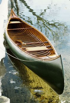 a CANOE is a lightweight narrow boat pointed at both ends, open on top, propelled by 1 or more seated / kneeling paddlers facing the direction of travel using a single-bladed paddle. It is used for racing, whitewater canoeing, touring and camping, freestyle, & general recreation & this dictates its hull shape & construction material. It used to be a dugout/ made of bark on a wood frame but slowly evolved to canvas on a wood frame then to Aluminum & now to  Fiberglass.