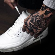 Bilderesultat for rose hand tattoo