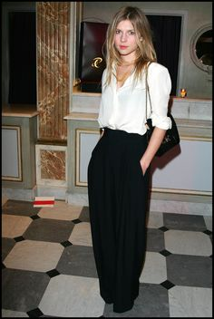 white blouse tucked into black wide-leg trousers