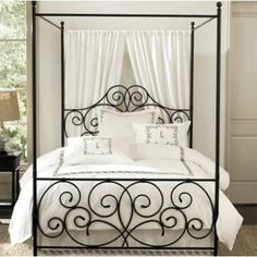 "Canopy bed with ""curtains"" behind the headboard. I like it."