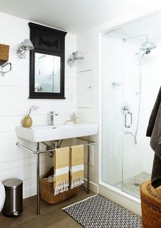 Cottage-Style Basement Bathroom-  A black mirror pops in this white space.