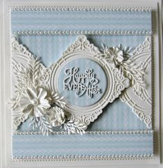 Good Sunday morning all!  Today's double day features the Happily Ever After die set.  This first card was started by embossing a piece...