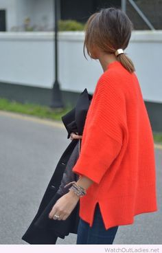 Orange blouse and ponytail cuff