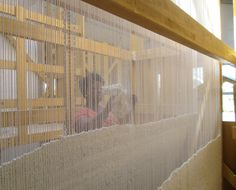 One of our fibre artists Neliswa weaving away