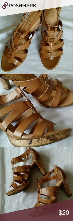 "Naturalizer Dafny Nude Sandals Dafny by Naturalizer is a stylish yet comfortable option for spring and summer! These nude sandals will go with about anything from dressy to casual!   Excellent used condition! No noted wear other than soles! *Last photo is truest color.*  True to size. Man-made but feels like soft leather! Heels are faux cork with excellent grip. Gold buckle detailing for added style.  Sadly, these bothered my ankles. Purchase today!  Heel: approx. 3.25""  Platform: approx…"