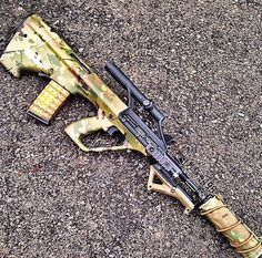 Suppressed STEYR AUG with sweet multicam dip and forward AFG