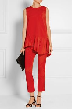 Tibi's boldly hued tunic is crafted from soft faille and woven with a touch of stretch. Finished with smart front darting, it's fully lined and falls to a flattering ruffled peplum hem. Continue a streamlined look with the matching pants.  - Red stretch-faille - Concealed hook and zip fastening at back - 58% acetate, 37% polyamide, 5% elastane; lining: 100% polyester - Dry