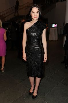 """Trading lace and satin for an asymmetrical leather dress, """"Downton Abbey's"""" Michelle Dockery is hardly recognizable as her alter ego, Lady Mary."""