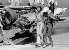 Tim Richmond of Charlotte, NC assists racing driver Dale Earnhardt