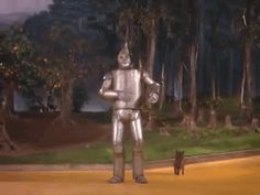 """The steam shooting from the Tin Man's cap startles Toto, who runs out of the shot. 