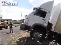STRANGE ROADWAY DANGERS - WRECKER USING CABLE TO PULL OUT STUCK TRUCK CLOTHES LINES UNAWARE MOTORCYCLIST - THAT'S GOTTA HURT! - DANGEROUS ACTION GIF!