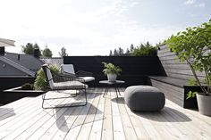 simple, minimal rooftop deck with built-in seat bench and clean modern outdoor furniture