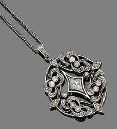 A late 19th century diamond-set pendant necklace  The oval openwork plaque, set throughout with old brilliant and rose-cut diamonds, to a fetter-link chain, mounted in platinum and gold, old brilliant-cut diamonds approx. 0.45ct total, lengths: pendant 4.6cm, chain 45.5cm