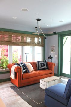 Love the orange couch (someday I'll have one), the green woodwork...everything, except maybe the blue chair, for me, I would like it to be a different color, maybe a large print