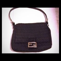 """FENDI ZUCCA MAMA BAG AUTHENTIC """"FENDI"""" ZUCCA MAMA BAG IN BLACK. SILVER HARDWARE WITH LEATHER ADJUSTABLE STRAP, SNAP CLOSURE. ONE INTERIOR ZIP POCKET. 17.5"""" STRAP. 9"""" / 11"""" W.  SILVER LOGO ON FRONT HAS A FEW SCRATCHES. IT HAS BEEN STITCHED INSIDE. PICTURE WILL SHOW. GREAT CONDITION. PURCHASED FROM ANOTHER POSH FRIEND. FENDI Bags"""
