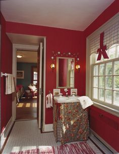 Bright red makes this bath really spectacular. Dark colors do work in small rooms.  #homedecor #bathrooms