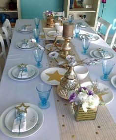 Pretty place settings at a turquoise and gold Christmas party! See more party planning ideas at CatchMyParty.com!