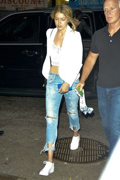 in New York wearing an ASOS crop top and ripped jeans.