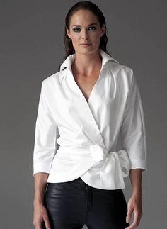 With its shaped 3/4 sleeves and x-over front the white Abigail shirt will effortlessly update your winter wardrobe.The Abigail in white features a wrap around style with bow tie detailing. The tie clinches in the waist and finishes with a generous bow, allowing the Abigail to be flattering on most figures and great on a bust. The Abigail is also available in the colours Ruby and Khaki.95% Cotton / 5% ElastaneBody length: Sizes 8 to12 - 67/69 cm, 14 to 18 - 70/71cm