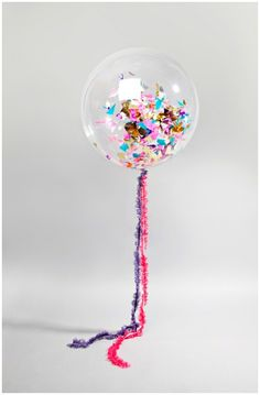 Balloons with confetti and fun strings