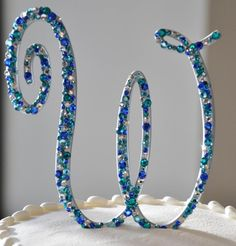 Cool idea for a personalized and sparkly cake topper.
