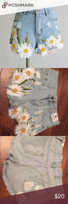 Daisy Embroidered Denim Shorts distressed denim shirts with super cute daisy embroidery! I love these but they are too short for me. I'm about a 0 and they fit my waist though.  *not urban* Urban Outfitters Shorts Jean Shorts
