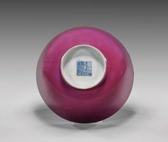 """QIANLONG ENAMELED BLUE & WHITE BOWL 18th Century Chinese, Qianlong Period porcelain footed bowl: the interior with blue and white design of large lotus blossoms and meandering vines; the exterior of monochrome pink glaze; with seal Mark and of the Period; D: 5 1/2"""""""