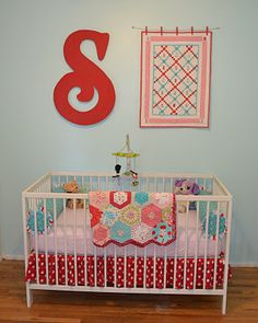 Nursery Decor: Vintage red  aqua accents...cute way to display an heirloom quilt (hang with red clothespins). (from Variety is the Spice, varietypac.blogspot.jp)