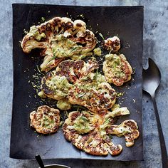"Cauliflower Steaks with Herb Salsa Verde | ""It's amazing how meaty cauliflower can be,"" chef Alex Guarnaschelli says. Here, she treats the vegetable like steak, searing thick planks and topping them with a super-tangy salsa verde. #FOODWINEWOMEN"