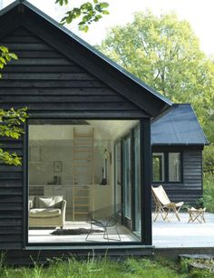 The Vinkelhuset Line is a modular prefab by Møn Huset. Tagged: Exterior, Cabin Building Type, and Prefab Building Type. Photo 3 of 14 in 13 Modern Prefab Cabins You Can Buy Right Now Design Exterior, Black Exterior, Exterior Paint, Modern Exterior, Bungalow Exterior, Exterior Houses, Exterior Shutters, Bungalow Homes, Exterior Cladding