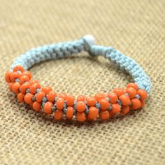 A pretty way to braid a Chinese crown knot bracelet step by step!Only waxed cord and 4mm round seed beads required!