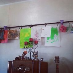 Showcase your kids artwork in your house by hanging a curtain rod on the wall. Super easy to update. Plus its a good way to show them how special you think they are.