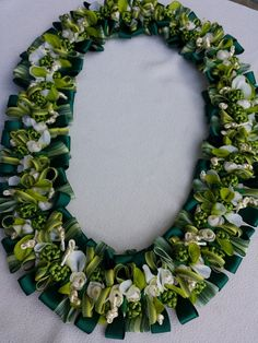 The lei is approximately 38 inches long, flat lei  material/satin ribbon、rattail cord, silk flower