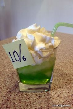 """MAD HATTER     1 part Vodka   1 part Sweet & Sour mix   1 part Midori melon liquor     Garnish with a Whip Cream """"Hat"""" and perhaps a 10/6 """"Post It"""" as shown! ENJOY!     And stay tuned for more Magical Drinks from Chef BigFatPanda here on the Disney Food Blog!         Recipe Courtesy Chef BigFatPanda   @Bigfatpanda Disneyworlds"""